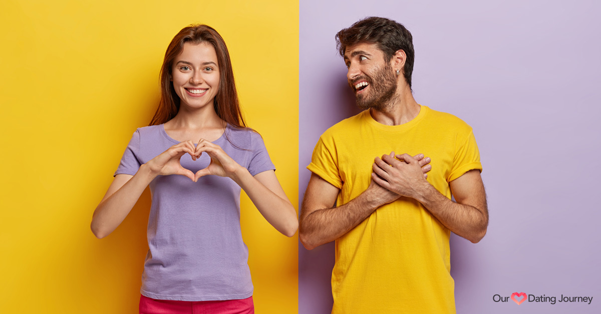 A woman and man showing a heart gesture