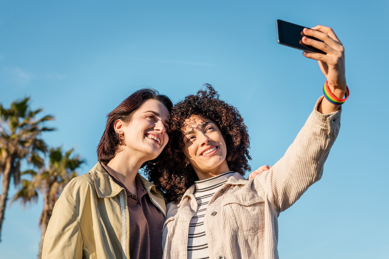 Multiracial couple gay women taking photo