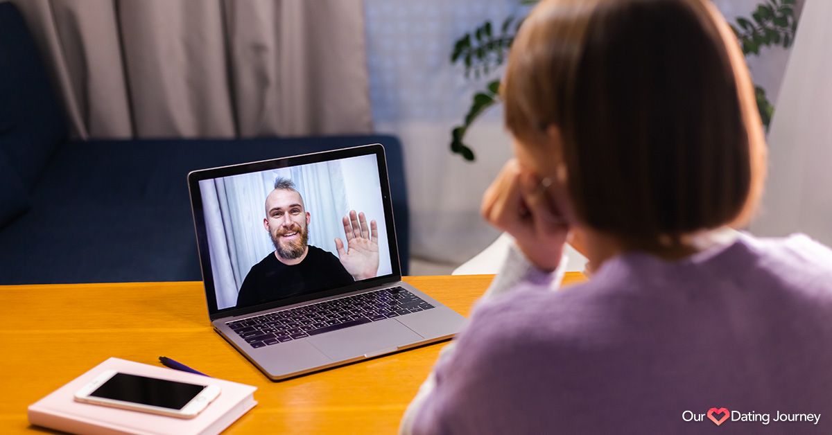 Woman at home video chatting with boyfriend