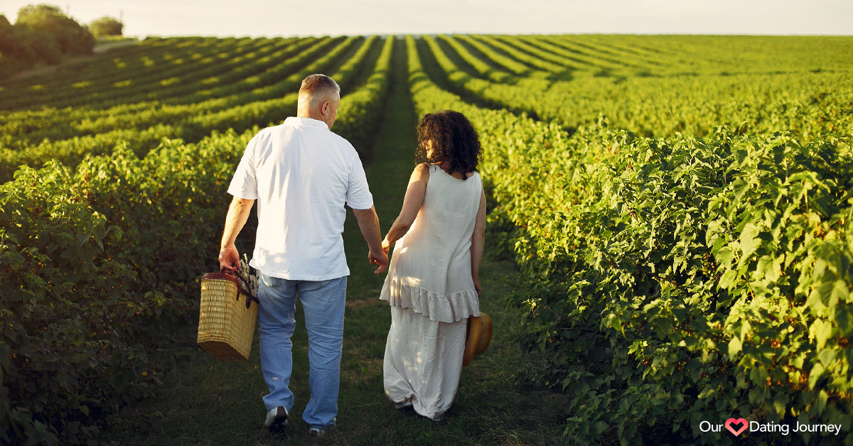 Mature man and woman walking in a plant field