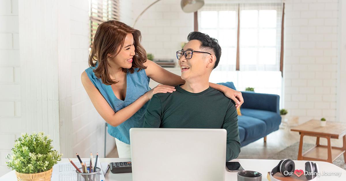 cheerful Asian couple talking