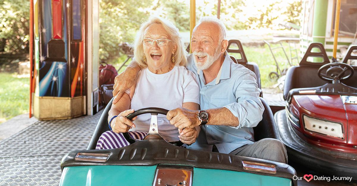 Senior couple driving bumper cars